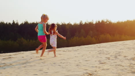 Two-Cheerful-Girl-Running-A-Race-On-The-Sand-At-Sunset-Children-s-Games-A-Happy-Childhood-Prores-Hq-
