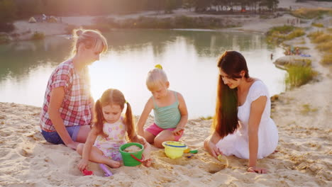 Two-Mothers-Playing-Sand-With-Two-Daughters-3-And-5-Years