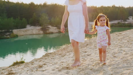 Mother-And-Daughter-Walking-On-The-Beach-At-The-Beautiful-Lake-With-Azure-Water-My-Mother-Is-A-Girl-