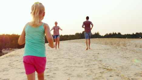 Girl-Playing-With-His-Parents-Runs-Them-Through-The-Sand-On-The-Beach-Prores-Hq-422-10-Bit-Video