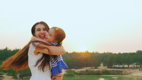 Mom-Plays-With-Her-Daughter-Hugging-And-Turning-It-Into-Sunset