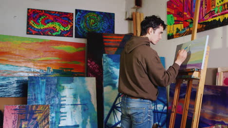 Working-In-The-Creative-Studio-Of-The-Painter-Young-Mixed-Race-Artist-Paints-A-Picture