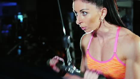 Determination-And-Motivation-Athletic-Woman-At-The-Gym-Trains-Hands-Female-Bodybuilding-Slow-Motion