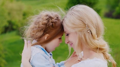 Portrait-Of-A-Curly-Blond-Girl-And-Her-Mother-Tenderness-Care-And-Maternal-Love