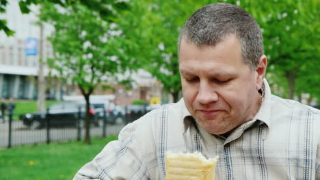 Brutal-Middle-Aged-Man-To-Eat-Fast-Food-Outdoors