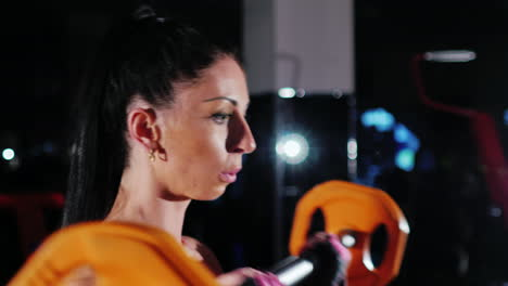Athletic-Woman-Trains-Muscles-Of-The-Hands-With-A-Barbell-Female-Bodybuilding