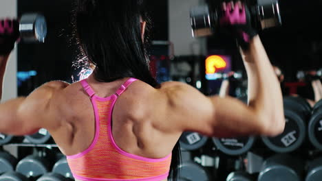 Self-Confident-Athletic-Woman-Is-Engaged-In-A-Sports-Hall-Trains-With-A-Dumbbell-Slow-Motion