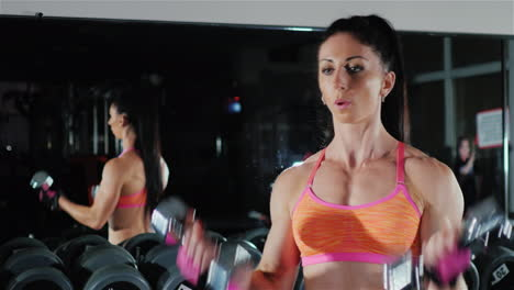 Athletic-Woman-Trains-Muscles-Of-The-Hands-Female-Bodybuilding