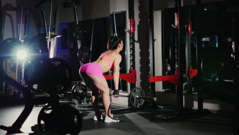 Motivation-And-Commitment-To-The-Sport-Athletic-Woman-Training-In-Agym-In-The-Spotlight-Female-Bodyb
