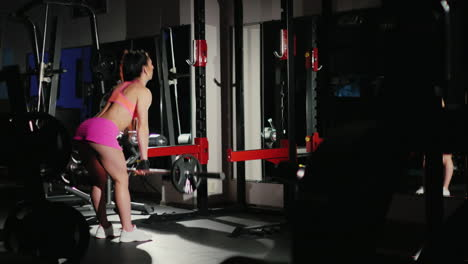 Motivation-And-Commitment-To-The-Sport-Athletic-Woman-Training-In-A-Gym-In-The-Spotlight-Female-Body
