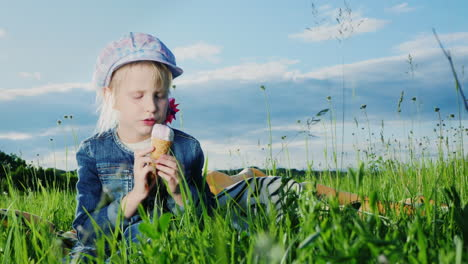 5-Year-Old-Girl-Eating-Ice-Cream-In-Green-Meadow-01