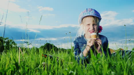 6-Year-Old-Girl-Eating-Ice-Cream-In-Green-Meadow-02