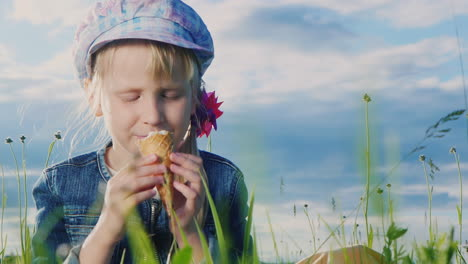 7-Year-Old-Girl-Eating-Ice-Cream-In-Green-Meadow-03