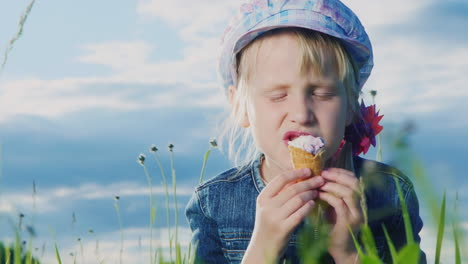 8-Year-Old-Girl-Eating-Ice-Cream-In-Green-Meadow-04