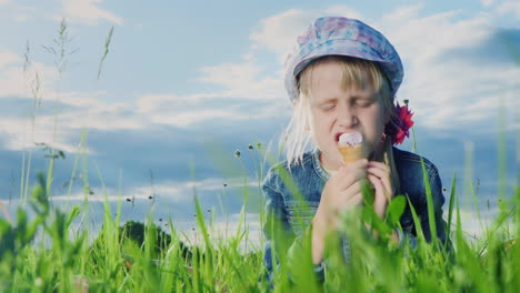 9-Year-Old-Girl-Eating-Ice-Cream-In-Green-Meadow-05