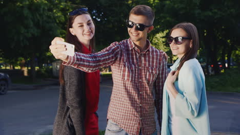 Friends-Sunglasses-Make-Selfie-A-Man-And-Two-Women-Hd-Video