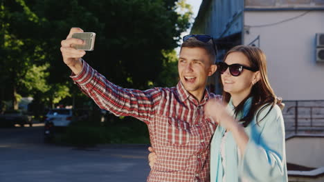 A-Loving-Couple-Makes-Selfie-In-The-Rays-Of-The-Sun-Outdoors-Hd-Video