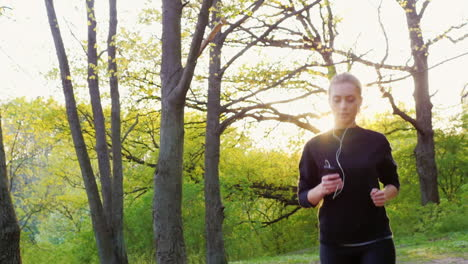 Steadicam-Slow-Motion-Shot-An-Attractive-Young-Woman-Makes-A-Morning-Jog-In-The-Forest-The-Sun-Is-Sh