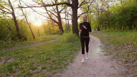 Jogging-In-Spring-Forest-Woman-Running-In-The-Forest-The-Sun-Is-Shining-It-In-The-Back