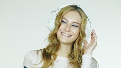 Attractive-Woman-Dancing-And-Listening-To-Music-Video-Shot-In-The-Studio-On-A-White-Background-Hd-Vi