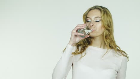 Young-Woman-Drinks-Water-From-A-Glass-On-A-White-Background-Hd-Video