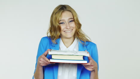 Female-Student-Holding-A-Stack-Of-Textbooks-And-Exercise-Books-Smiling-Hd-Video