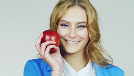 Portrait-Of-An-Attractive-Young-Woman-With-Red-Apple-Hd-Video