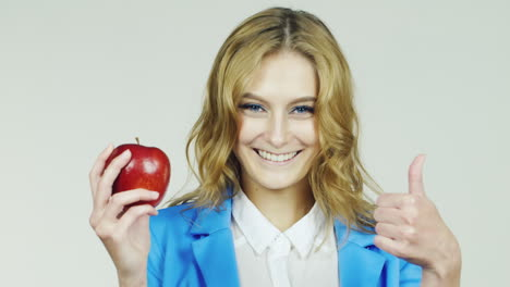 Girl-With-Red-Apple-In-His-Hand-Showing-Approval-Gesture-With-Thumb-Up-Hd-Video