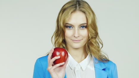 Attractive-Woman-With-Red-Apple-It-Shows-Thumb-Up-Healthy-Lifestyle-Hd-Video