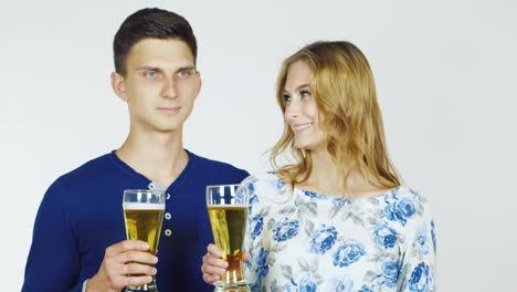 Man-And-Woman-With-Beer-Glasses-On-A-White-Background-Hd-Video