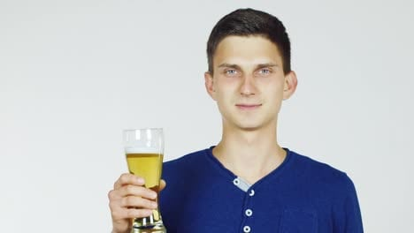 A-Young-Man-With-A-Glass-Of-Beer-On-A-White-Background-Hd-Video