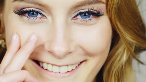 Portrait-Of-A-Young-Blue-Eyed-Woman-Stroking-Her-Face-With-His-Fingertips-Hd-Video