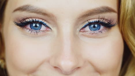 Blue-Eyes-Of-A-Young-Woman-Who-Is-Smiling