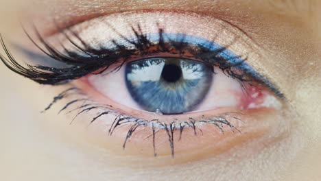The-Eye-Of-A-Young-Woman-With-Blue-Eyes-Looking-Directly-Hd-Video