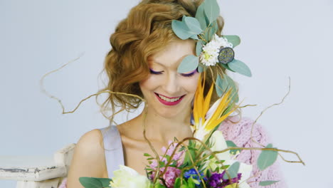 Portrait-Of-A-Young-Woman-Holding-Flowers-In-Her-Hair