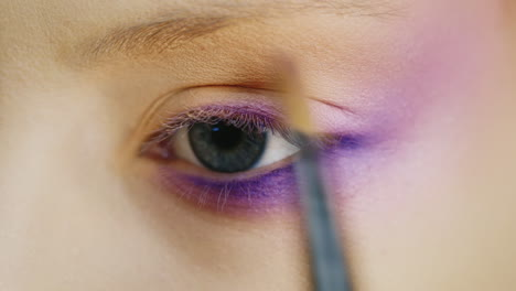 Apply-Makeup-On-A-Beautiful-Female-Eye-Of-Blue-Color