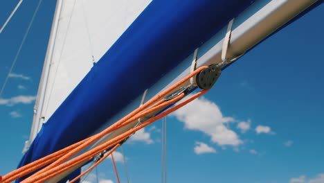 Sail-And-A-Piece-Of-Rigging-Yacht-Against-The-Blue-Sky