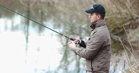 Fisherman-Holding-Fishing-Rod-In-Hands-1