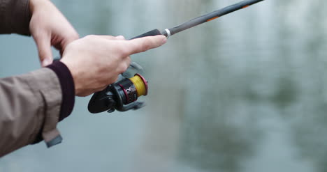 Fisherman-Holding-Fishing-Rod-In-Hands-2