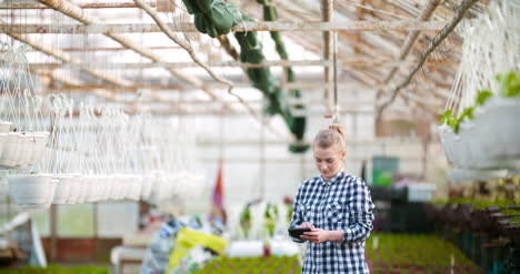 Agriculture-Female-Gardener-Working-In-Greenhouse-4
