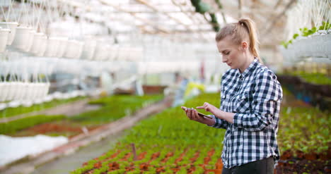 Agribusiness-Female-Farmer-Working-In-Greenhouse-2