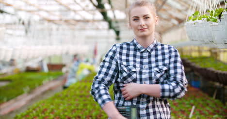 Agriculture-Female-Gardener-Working-In-Greenhouse-6