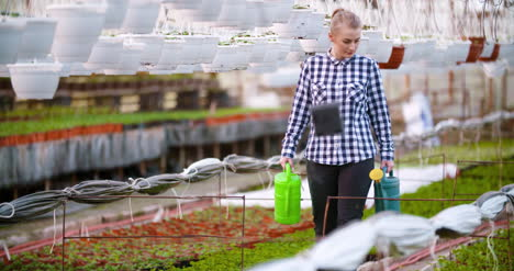 Agriculture-Female-Gardener-Working-In-Greenhouse-7