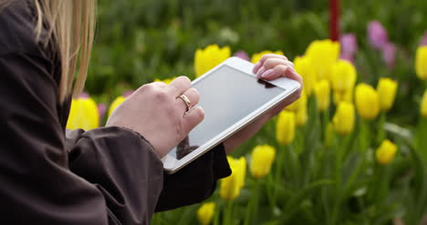Agriculture-Technology-Farmer-Using-Tablet-At-Flower-Plantation-1