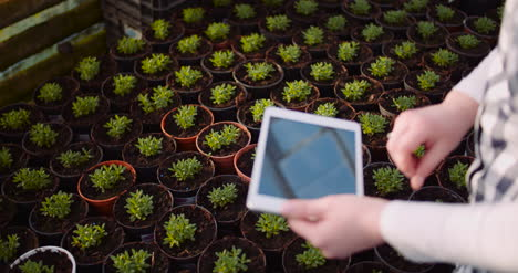 Gardener-Using-Digital-Tablet-In-Greenhouse-5