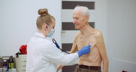 Female-Doctor-Examine-Elderly-Man-With-Stethoscope