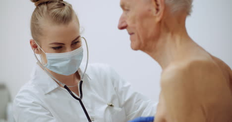 Female-Doctor-Examine-Elderly-Man-With-Stethoscope-2