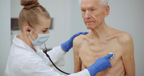 Female-Doctor-Examine-Elderly-Man-With-Stethoscope-5