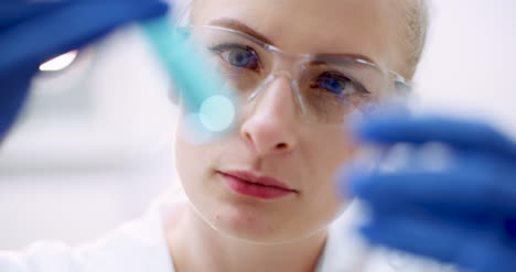 Portrait-Of-Female-Scientist-With-A-Pipette-Analyzes-A-Liquid-To-Extract-The-Dna-In-Lab