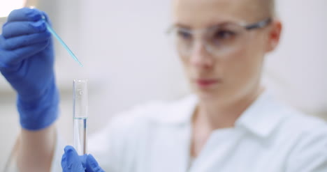 Portrait-Of-Female-Scientist-With-A-Pipette-Analyzes-A-Liquid-To-Extract-The-Dna-In-Lab-3